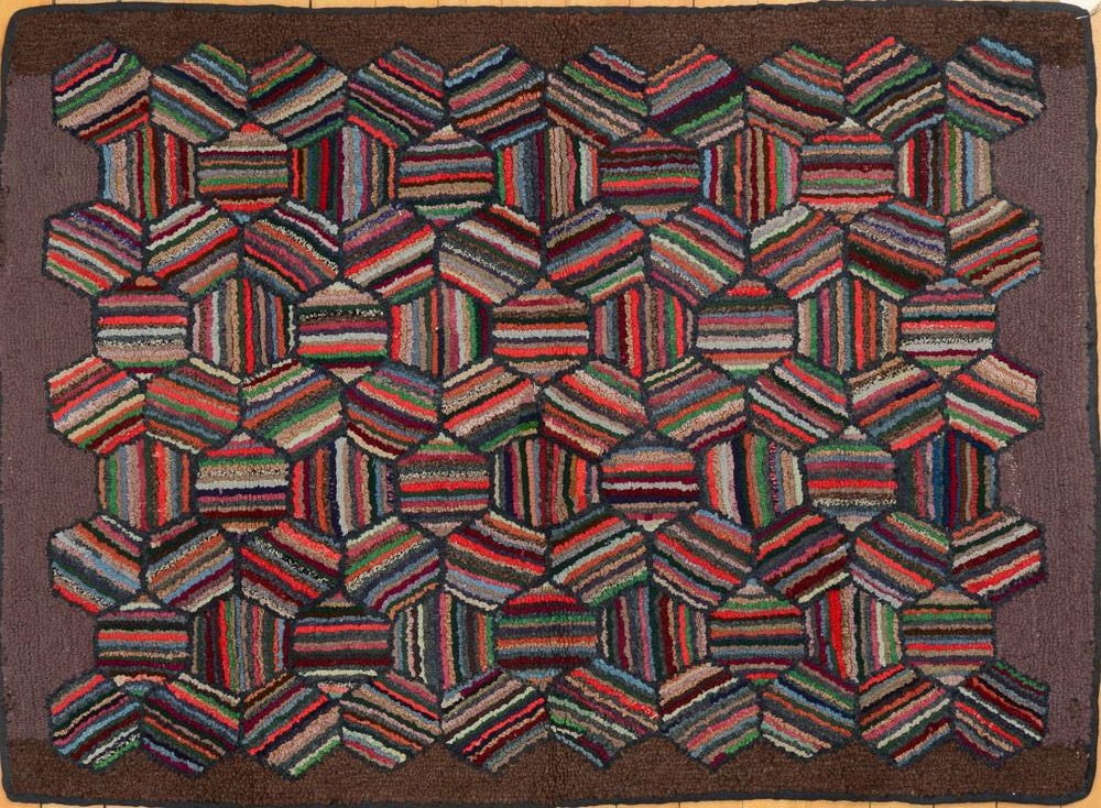 This is Lot 421 in the same auction, described as: AMERICAN HOOKED RUG  Worked with tightly woven striped hexagons. 3 ft. 2 in. x 4 ft. 4 in.